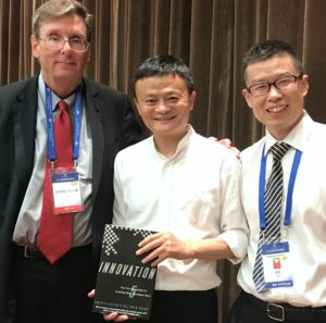 "Jack Ma with Curt Carlson and John Zhang. The book is ""Innovation"" by Carlson and Wilmot."