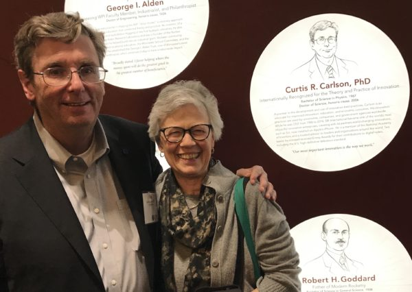 Curt and Dudley Carlson at the WPI award wall.